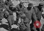 Image of German prisoners guarded by US MPs during World War II Periers France, 1944, second 62 stock footage video 65675072547