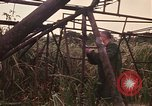 Image of recovery of LB-7 aircraft Bluefields Nicaragua, 1969, second 20 stock footage video 65675072638