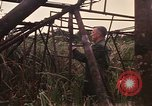 Image of recovery of LB-7 aircraft Bluefields Nicaragua, 1969, second 21 stock footage video 65675072638