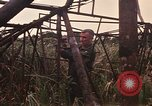 Image of recovery of LB-7 aircraft Bluefields Nicaragua, 1969, second 23 stock footage video 65675072638