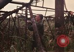 Image of recovery of LB-7 aircraft Bluefields Nicaragua, 1969, second 25 stock footage video 65675072638