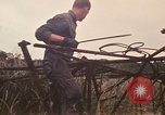 Image of recovery of LB-7 aircraft Bluefields Nicaragua, 1969, second 26 stock footage video 65675072638