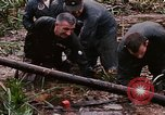 Image of recovery of LB-7 aircraft Bluefields Nicaragua, 1969, second 23 stock footage video 65675072640