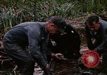 Image of recovery of LB-7 aircraft Bluefields Nicaragua, 1969, second 26 stock footage video 65675072640
