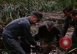 Image of recovery of LB-7 aircraft Bluefields Nicaragua, 1969, second 31 stock footage video 65675072640