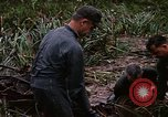 Image of recovery of LB-7 aircraft Bluefields Nicaragua, 1969, second 34 stock footage video 65675072640