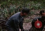 Image of recovery of LB-7 aircraft Bluefields Nicaragua, 1969, second 39 stock footage video 65675072640