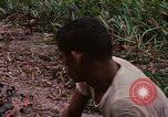 Image of recovery of LB-7 aircraft Bluefields Nicaragua, 1969, second 46 stock footage video 65675072640