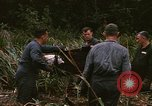 Image of recovery of LB-7 aircraft debris Bluefields Nicaragua, 1969, second 18 stock footage video 65675072642