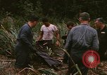 Image of recovery of LB-7 aircraft debris Bluefields Nicaragua, 1969, second 21 stock footage video 65675072642