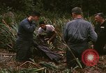 Image of recovery of LB-7 aircraft debris Bluefields Nicaragua, 1969, second 23 stock footage video 65675072642