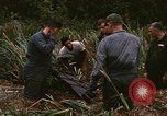 Image of recovery of LB-7 aircraft debris Bluefields Nicaragua, 1969, second 24 stock footage video 65675072642