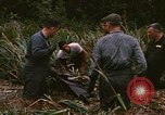 Image of recovery of LB-7 aircraft debris Bluefields Nicaragua, 1969, second 25 stock footage video 65675072642