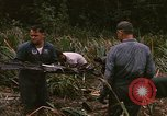 Image of recovery of LB-7 aircraft debris Bluefields Nicaragua, 1969, second 32 stock footage video 65675072642