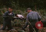 Image of recovery of LB-7 aircraft debris Bluefields Nicaragua, 1969, second 33 stock footage video 65675072642
