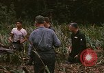 Image of recovery of LB-7 aircraft debris Bluefields Nicaragua, 1969, second 37 stock footage video 65675072642