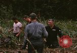 Image of recovery of LB-7 aircraft debris Bluefields Nicaragua, 1969, second 39 stock footage video 65675072642