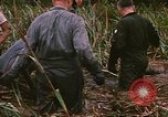 Image of recovery of LB-7 aircraft debris Bluefields Nicaragua, 1969, second 52 stock footage video 65675072642