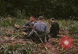 Image of recovery of LB-7 aircraft debris Bluefields Nicaragua, 1969, second 61 stock footage video 65675072642