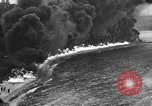 Image of fire wall off English coast to prevent German invasion United Kingdom, 1945, second 49 stock footage video 65675072721