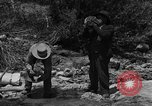Image of gold panning Arizona United States USA, 1920, second 1 stock footage video 65675072790