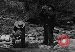 Image of gold panning Arizona United States USA, 1920, second 2 stock footage video 65675072790