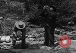 Image of gold panning Arizona United States USA, 1920, second 3 stock footage video 65675072790