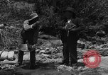 Image of gold panning Arizona United States USA, 1920, second 5 stock footage video 65675072790