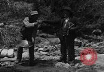 Image of gold panning Arizona United States USA, 1920, second 7 stock footage video 65675072790
