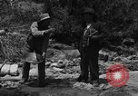 Image of gold panning Arizona United States USA, 1920, second 8 stock footage video 65675072790