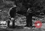 Image of gold panning Arizona United States USA, 1920, second 10 stock footage video 65675072790
