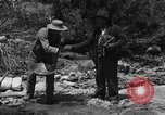 Image of gold panning Arizona United States USA, 1920, second 12 stock footage video 65675072790