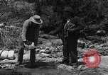 Image of gold panning Arizona United States USA, 1920, second 14 stock footage video 65675072790