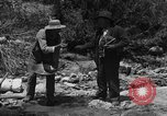 Image of gold panning Arizona United States USA, 1920, second 15 stock footage video 65675072790