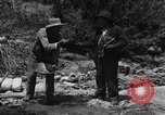 Image of gold panning Arizona United States USA, 1920, second 16 stock footage video 65675072790