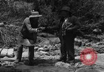 Image of gold panning Arizona United States USA, 1920, second 17 stock footage video 65675072790