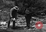 Image of gold panning Arizona United States USA, 1920, second 20 stock footage video 65675072790