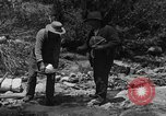 Image of gold panning Arizona United States USA, 1920, second 21 stock footage video 65675072790