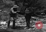 Image of gold panning Arizona United States USA, 1920, second 22 stock footage video 65675072790