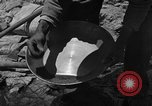 Image of gold panning Arizona United States USA, 1920, second 24 stock footage video 65675072790
