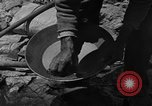Image of gold panning Arizona United States USA, 1920, second 26 stock footage video 65675072790