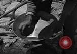 Image of gold panning Arizona United States USA, 1920, second 30 stock footage video 65675072790