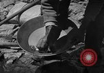 Image of gold panning Arizona United States USA, 1920, second 31 stock footage video 65675072790
