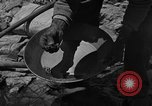 Image of gold panning Arizona United States USA, 1920, second 32 stock footage video 65675072790