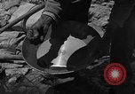 Image of gold panning Arizona United States USA, 1920, second 33 stock footage video 65675072790