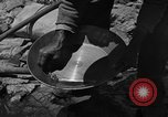 Image of gold panning Arizona United States USA, 1920, second 34 stock footage video 65675072790