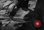 Image of gold panning Arizona United States USA, 1920, second 36 stock footage video 65675072790