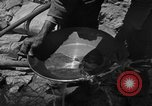 Image of gold panning Arizona United States USA, 1920, second 37 stock footage video 65675072790