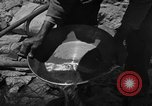 Image of gold panning Arizona United States USA, 1920, second 38 stock footage video 65675072790