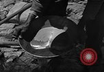Image of gold panning Arizona United States USA, 1920, second 39 stock footage video 65675072790